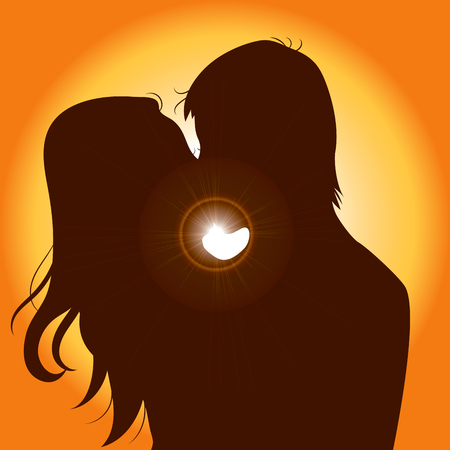Sunset silhouette of young couple kissing with sun on background