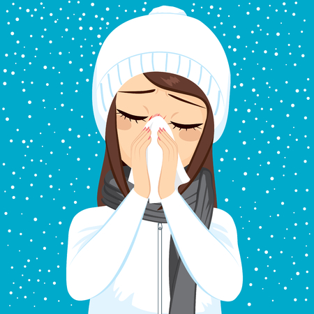 Young woman having flu blowing nose with white paper tissue on winter