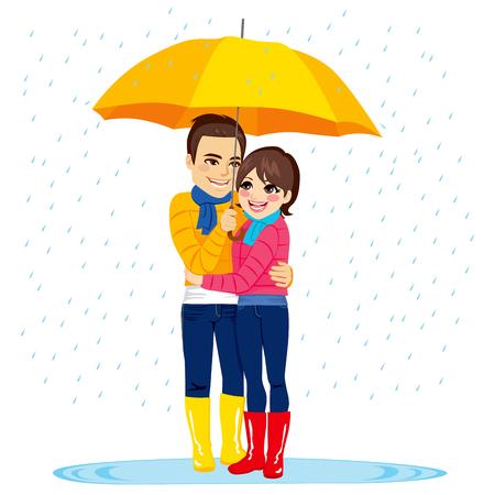 sotto la pioggia: Giovane coppia in piedi sotto la pioggia con ombrello giallo