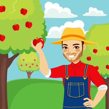 Jeune homme agriculteur cueillette pomme rouge d'arbre