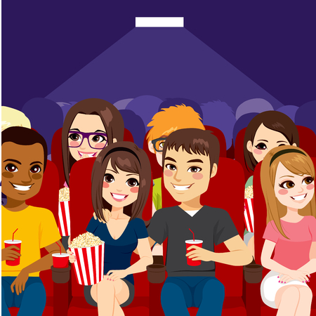 Young people watching a movie at cinema theater with popcorn and drinks
