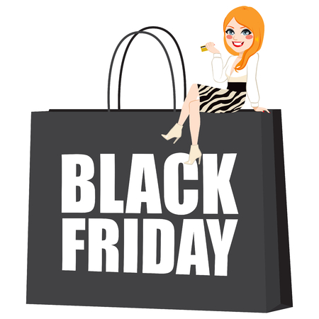Sexy red hair woman sitting on big black Friday shopping bag holding credit card