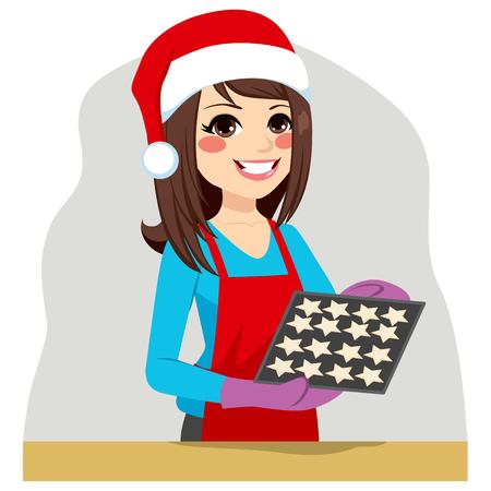 brunette: Beautiful brunette woman on Christmas time baking cookies