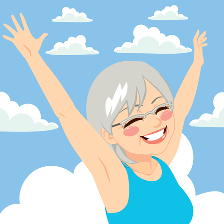 freedom woman: Senior woman raising arms up with blue sky background freedom concept