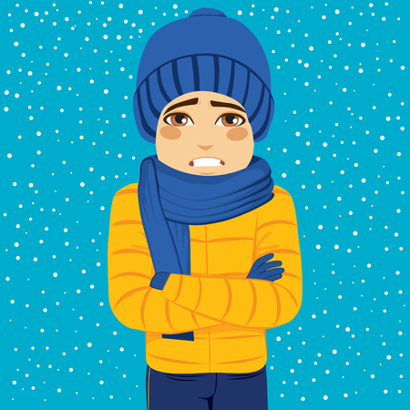 Man shivering in cold winter outdoors wearing warm clothes on snowy day