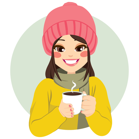 Beautiful woman wearing winter clothes having cup of hot chocolate