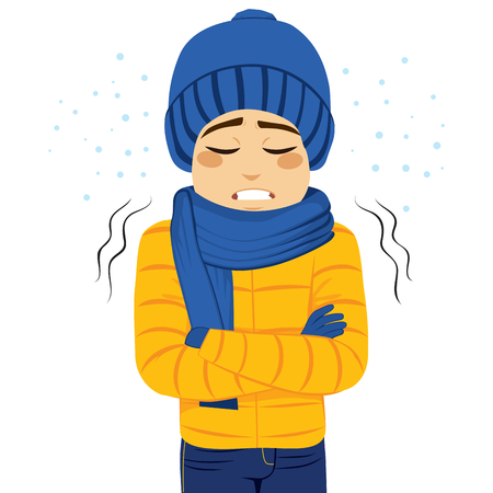 frigid: Young man freezing wearing winter clothes shivering
