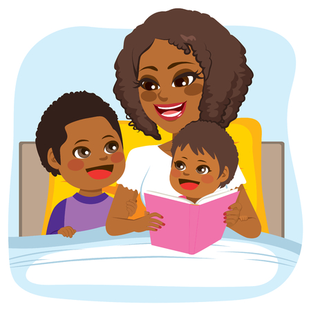 american stories: Young African American mother reading bed time tale story to son and daughter on bed