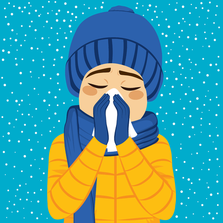 blowing nose: Young man having flu blowing nose with paper tissue on winter