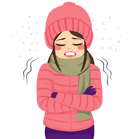 warm clothes: Young woman freezing wearing winter clothes shivering