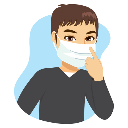 Young man wearing medical mask on face to prevent flu