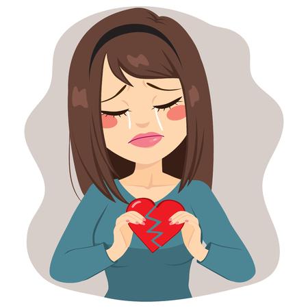 triste mujer joven que sostiene dos piezas de corazón roto a llorar