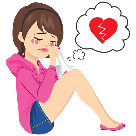 Young sad woman crying sitting on floor with broken heart on speech balloon