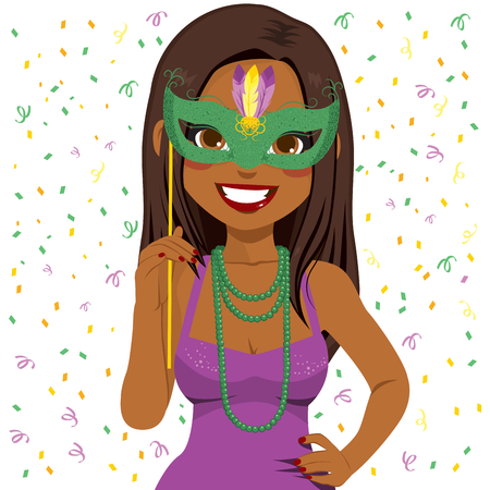 Beautiful young African American woman wearing Mardi Gras mask and beads