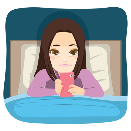 Young teenager girl using smartphone in bed addiction problem concept