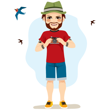 Young happy man taking photos of birds as a hobby