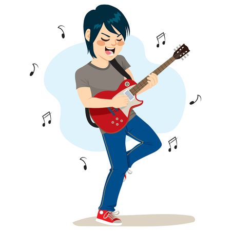pastime: Young boy playing electric guitar rock music