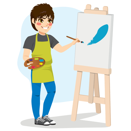 Young boy artist painting blue color paint brush stroke on canvas standing holding color palette