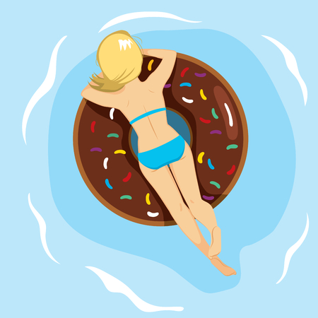 Woman lying back on inflatable doughnut shaped in summer at swimming pool