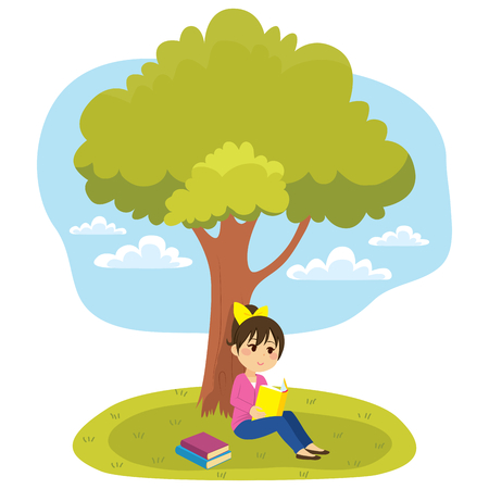 Young little girl reading a book under tree
