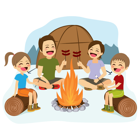 Happy family cooking sausages and marshmallows on campfire