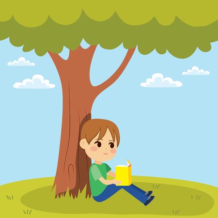 ツリーの下に座って本を読んで子供の少し若い