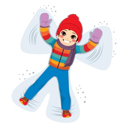 Young smiling boy enjoying making snow angel silhouette
