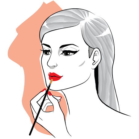 Beautiful young woman applying lipstick makeup on lips with brush.