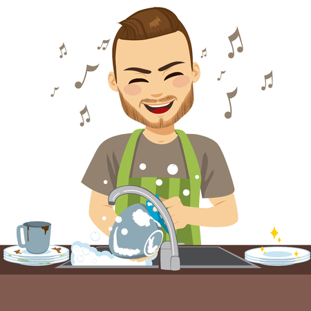 Young happy man wearing apron washing dirty dishes singing