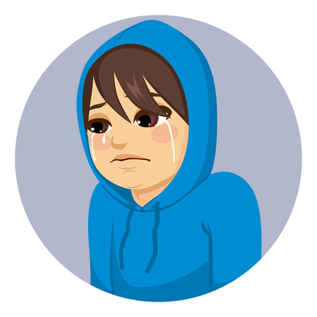 Crying sad teenager boy with blue hoodie covering his head sadness concept