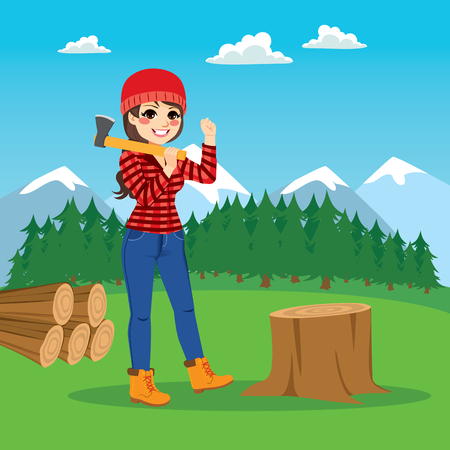 Beautiful brunette female lumberjack cutting tree with axe on forest background
