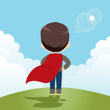 Back view of cute little super hero boy standing on high mountain with big blue sky and waving red cape