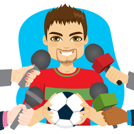 Young male soccer football player holding ball and hands holding microphones on interview