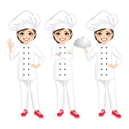 Young beautiful happy female chef holding silver tray and gesturing ok sign