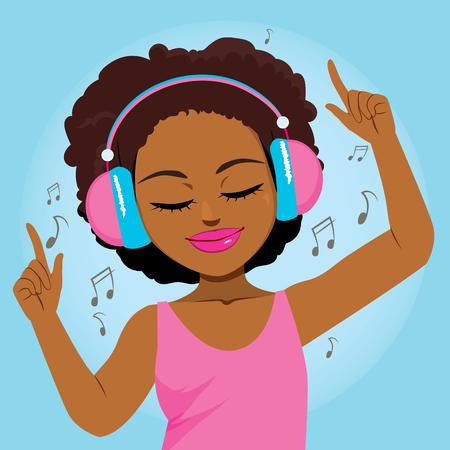 Hermosa joven negra disfrutando de la música con auriculares y bailando