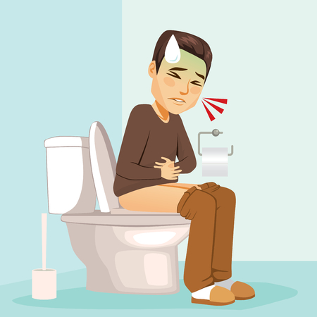 Young ill man with stomach problems sitting on lavatory toilet