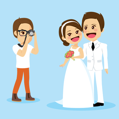 Cute newlywed couple in white dress on wedding day standing posing for photo session by professional photographer