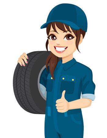 Female mechanic holding tire wheel making positive thumb up