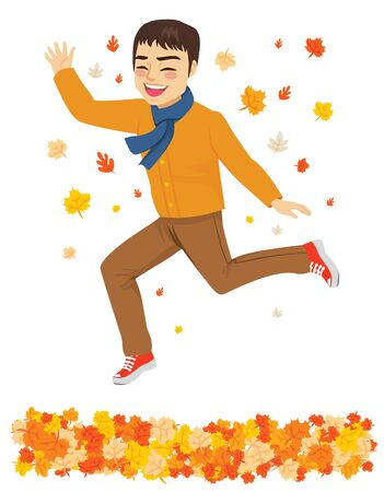 Happy autumn time fashion man jumping over fall leaves