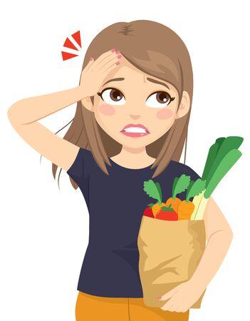 La giovane donna adolescente si accorge di aver dimenticato qualcosa sulla lista della spesa e fa il gesto del palmo del viso