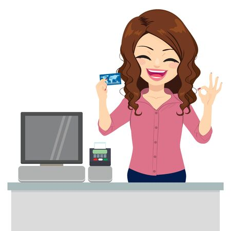 Beautiful female clerk holding credit card and making ok sign with hand Archivio Fotografico - 130825128