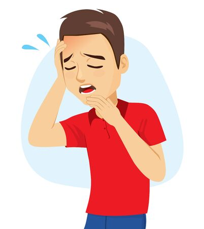 Young man with holding head with hand suffering headache fatigue migraine symptom