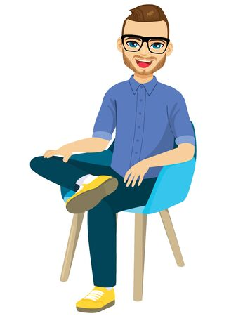 Bearded happy man with glasses in casual clothes sitting on chair