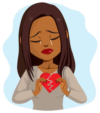 Beautiful young black woman crying sad while holding broken heart concept