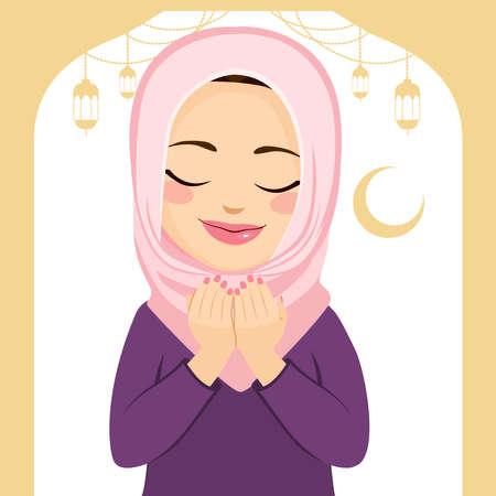 Beautiful Muslim woman praying with eyes closed during Ramadan