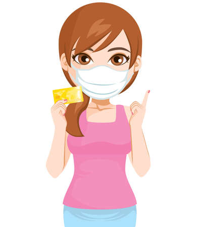 Woman holding credit card wearing medical face mask covid-19 pandemic and contactless shopping concept