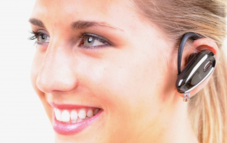 A woman talking by phone through bluetooth photo