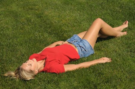 lesure: beautiful woman is lie down on the grass