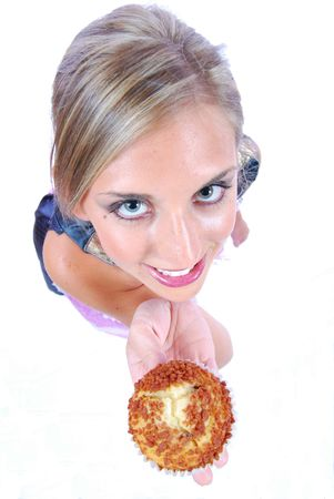 woman showing a piece of muffin Stock Photo - 3645897
