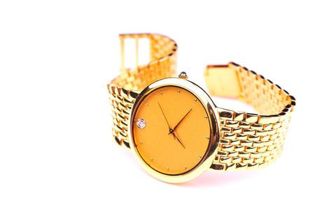 expensive: golden watch over white